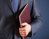 Businessman holding a book Stock Photos