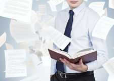 Businessman holding book Stock Photography