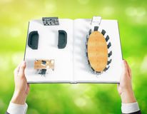 Businessman holding book with interior Stock Photography