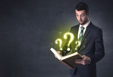 Businessman looking in a book. royalty free stock photos