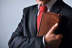 Businessman holding a book. Businessman in a suit holding a book Stock Photography