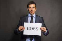 Businessman holding a boss board Stock Photos