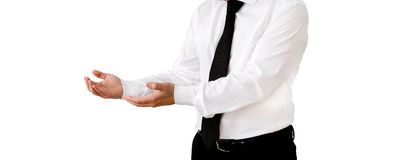 Businessman is holding with both hands. Businessman is stretching both arms forward, wearing shirt and tie with text free space stock photography