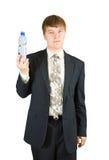 Businessman holding bottle Royalty Free Stock Photo