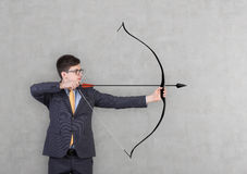 Businessman holding a bow Royalty Free Stock Images