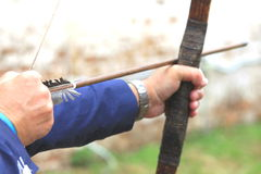 Businessman holding bow and shooting to archery target. Stock Images