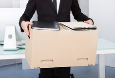 Businessman holding box Stock Image