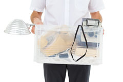 Businessman holding box of his things Stock Images