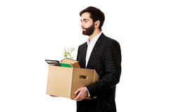 Businessman holding box with personal belongings. Royalty Free Stock Image