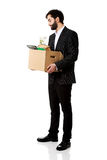 Businessman holding box with personal belongings. Royalty Free Stock Photo