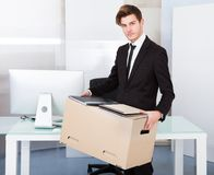 Businessman holding box Royalty Free Stock Image