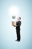 Businessman holding box Stock Photos
