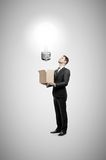 Businessman holding box Royalty Free Stock Photography