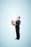 Businessman holding box Royalty Free Stock Image