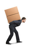 Businessman holding boxes Stock Photo