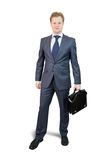 Businessman holding brief case Royalty Free Stock Photos