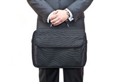 Businessman holding a briefcase Royalty Free Stock Images