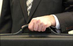 Businessman holding briefcase. Business concept Royalty Free Stock Image