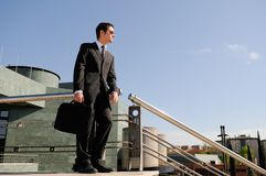 Businessman holding a briefcase Royalty Free Stock Photo