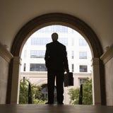Businessman holding briefcase. Stock Photos