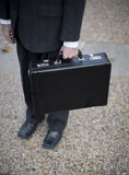 Businessman holding briefcase Royalty Free Stock Images