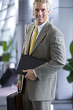 Businessman holding briefcase and file Royalty Free Stock Photos