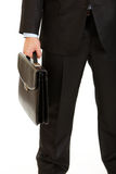 Businessman holding briefcase in hand. Close-up. Royalty Free Stock Photography
