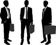Businessman holding briefcase silhouettes Stock Image