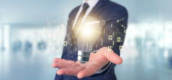 Businessman holding a bulb lamp idea concept with data all around 3d rendering. View of a Businessman holding a bulb lamp idea concept with data all around 3d stock photo