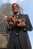 Businessman Holding Bull Royalty Free Stock Photos