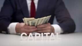 Businessman holding bundle of money in hands. Man recounts money capital. Cash capital for replenishment bank account stock footage