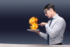 The businessman holding burning american dollar sign Royalty Free Stock Images