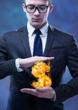 The businessman holding burning american dollar sign. Businessman holding burning american dollar sign Stock Photography