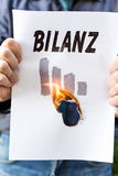 Businessman is holding a burning paper Stock Image