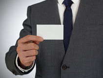 Businessman holding a business card Stock Photography