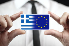 Businessman holding a business card with Greece and EU Flag Stock Photo