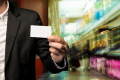 Businessman holding business card Stock Photography