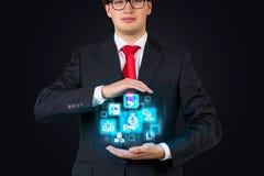 Businessman holding business interface Stock Photos