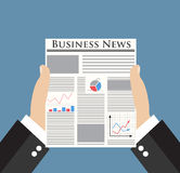 Businessman holding Business News newspaper Stock Photo