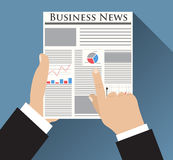 Businessman holding Business News newspaper Royalty Free Stock Image