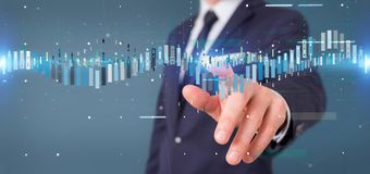 Businessman holding a Business stock exchange trading data information. View of a Businessman holding a Business stock exchange trading data information stock photos