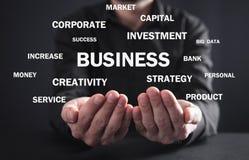 Businessman holding Business words. Business concept vector illustration