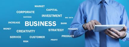 Businessman holding Business words. Business concept royalty free stock photography
