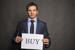 Businessman holding buy board Royalty Free Stock Images