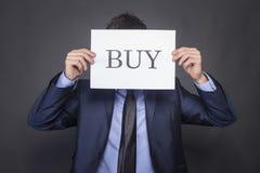 Businessman holding BUY Stock Photo