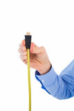 Businessman holding a cable Stock Image