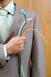 Businessman holding cables to chest, mid section Royalty Free Stock Photos