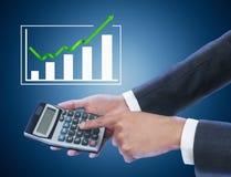 Businessman holding calculator Stock Photography