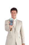 Businessman holding a calculator in his hands Stock Photo
