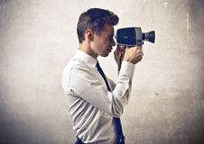 Businessman holding a camera Royalty Free Stock Image